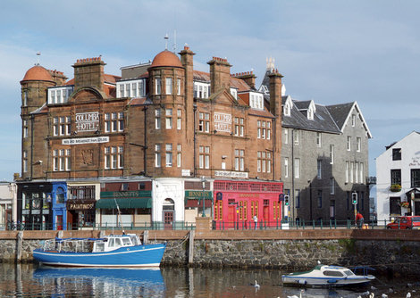 Exterior view of the Columba hotel in Oban, the victorian building is overlooking the seafront.