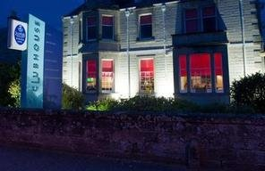 Exterior Image Of The Victorian Villa Clubhouse Hotel In Nairn All Light Up At Night